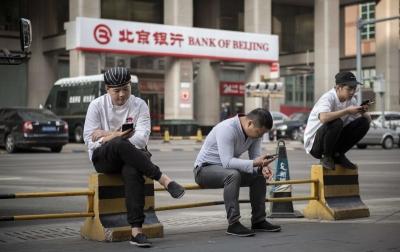 China Terapkan Pemindai Wajah untuk Mendaftar Kontak Ponsel