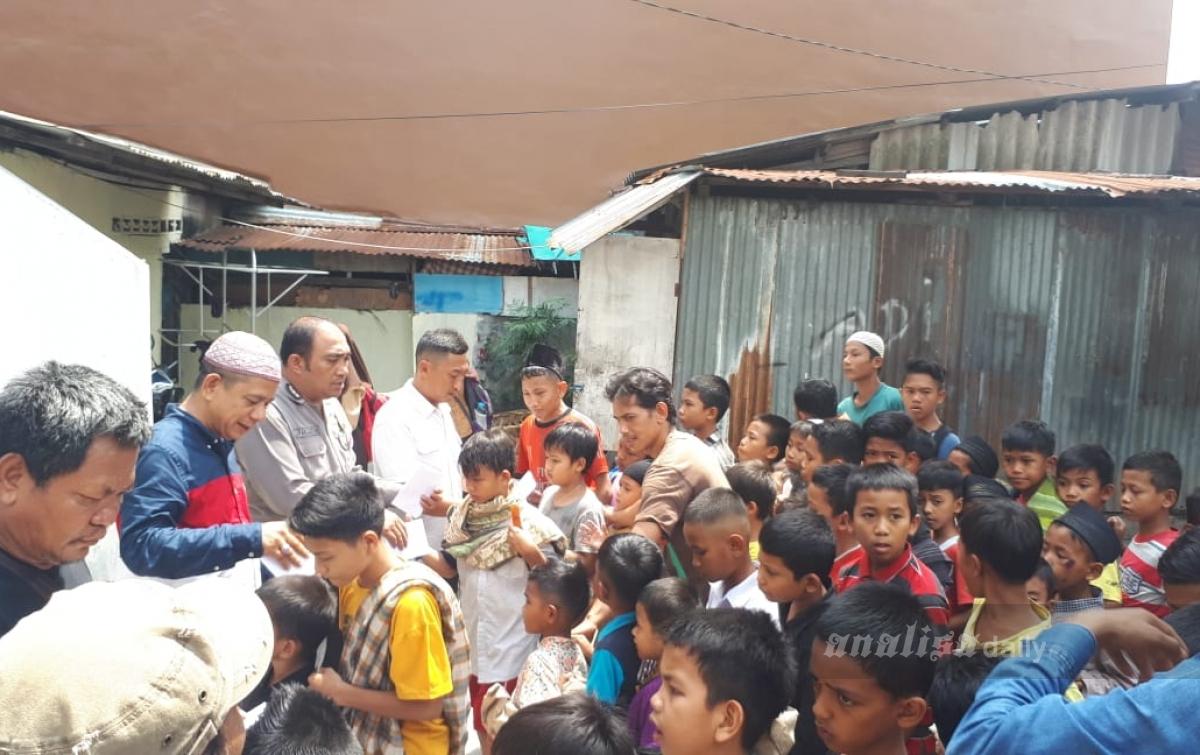 Pewarta Polrestabes Medan Santuni 100 Anak Yatim