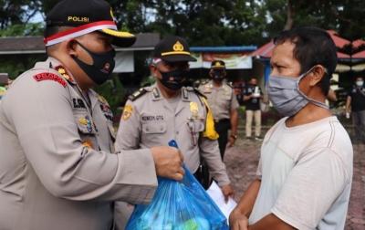 HUT Bhayangkara, Polres Langkat Bagikan 500 Paket Sembako