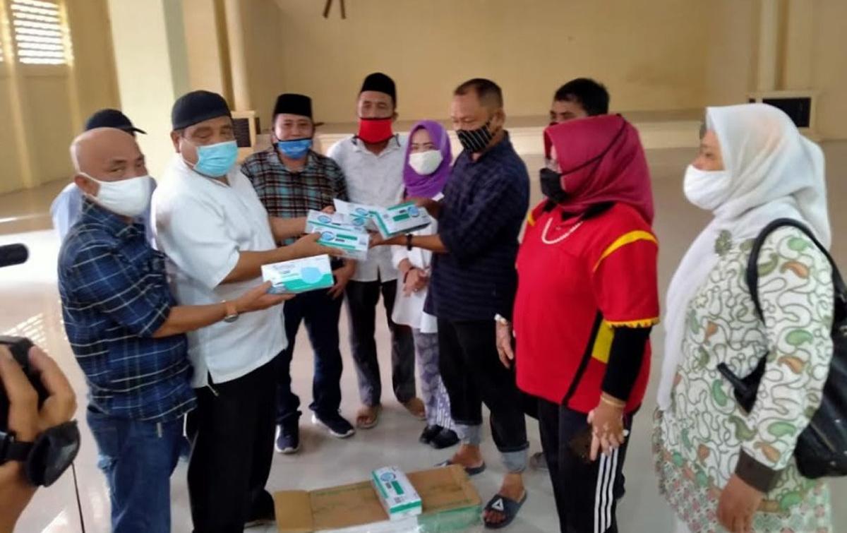 PWI Sumut Distribusikan Masker Bantuan Gajah Tunggal Group