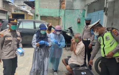 Polsek Tanjung Pura Swab Antigen Gratis di Pasar Tradisional